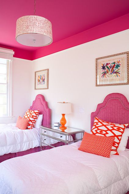 Here's an example of how you can visually lower a tall ceiling using color. With the hot-pink ceiling color extended down the wall a foot or...