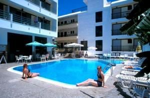 Poseidon Hotel and Apartments Kos Town. Poseidon Hotel is 800 metres from Kos Town, and 200 metres from the closest beach and the promenade. Offering free Wi-Fi in its public areas, the hotel features an outdoor pool and air-conditioned rooms with large balcony. Rooms have a TV with local and satellite channels, safe and facilities for tea and coffee making, and there is a hairdryer in the bathroom. Some rooms have views over the pool. KosExplorer.com -