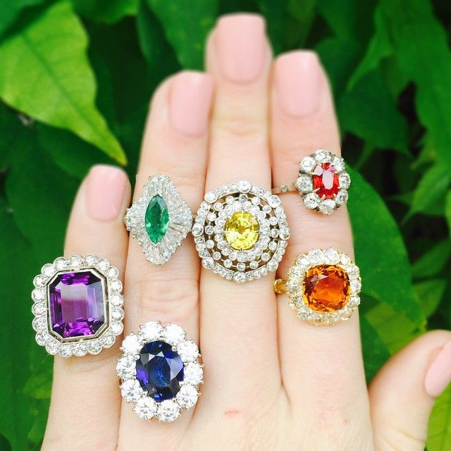 Taste the rainbow with our #vintage colored stone #diamond cluster #rings featuring red spinel, orange citrine, yellow #sapphire, green #emerald, blue sapphire and purple amethyst at #CraigEvanSmall! #vintagejewelry #vintagering #diamonds