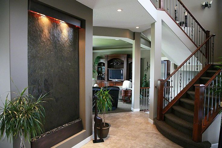 An indoor waterfall wall adds to the style quotient of the home