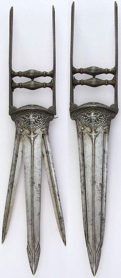 """Indian """"sissors"""" katar, 18th to 19th century, L. 19 1/4 in. (48.9 cm); W. 3 3/16 in. (8.1 cm); Wt. 30.5 oz. (864.7 g), Met Museum,  Bequest of George C. Stone, 1935."""