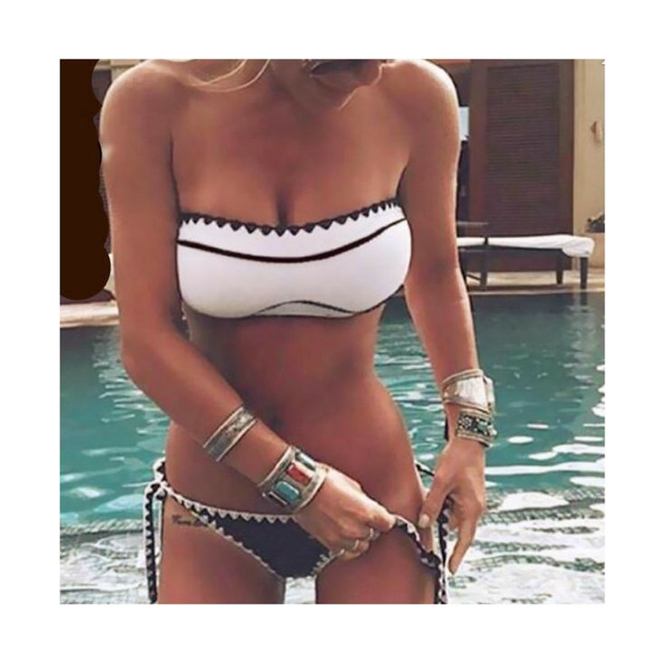 TUBE BIKINI: An adorable unstructured tube top bikini, with shell print, art deco style pattern. Tie bottoms, supportive top and great detailing all make this a winner!