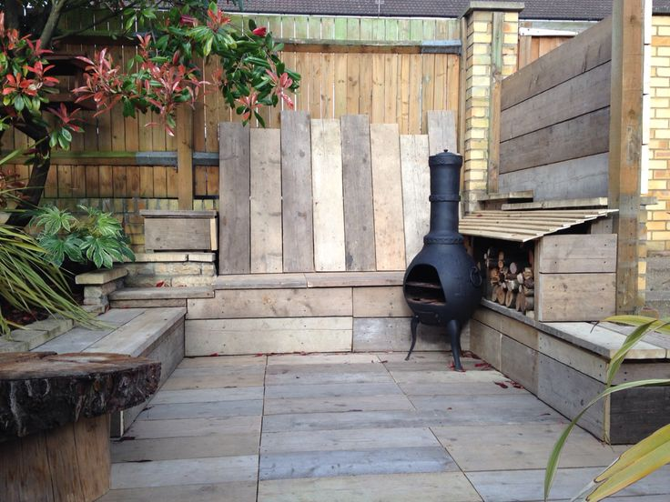 Scaffold Board Decking And Seated Area Cosy With Chimenea And Wood Store Garden Design