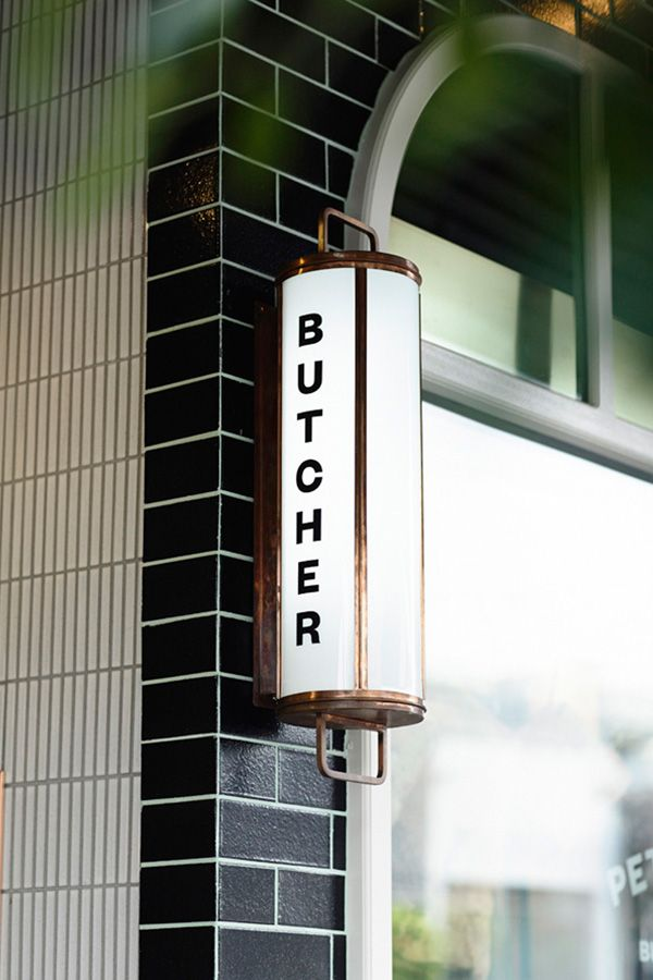 A tiled façade of black and terracotta sets the tone for the new-look retail space of premium Hawksburn butcher Peter Bouchier. Inside, finishes of copper, green mirror and marble bench tops reflect heritage and dedication to quality – characteristics that have seen Bouchier become a valued fabric of its neighbourhood.