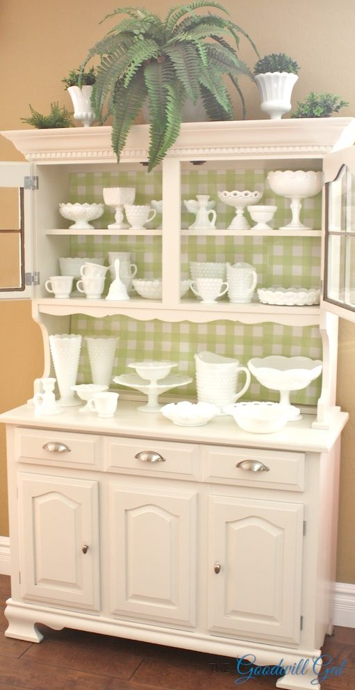 My hutch from #Goodwill showing off my #Milk Glass collection for Spring. #thrift #decor