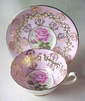 Royal Grafton Pink and Gold Gilt tea cup and saucer with large rose in center by SarahSmith