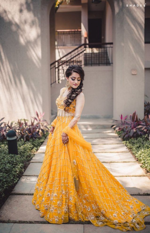 68b72262d3 Gorgeous yellow lehenga with hanging tassels for sangeet function. See more  on wedmegood.com #wedmegood #indianbride #indianwedding #lehenga # lehengacholi ...