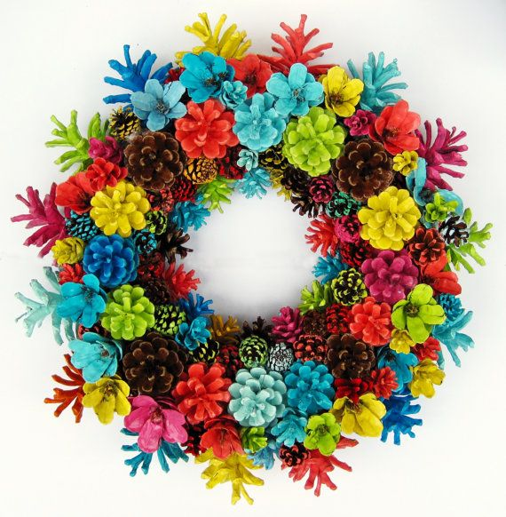 This pine cone wreath is crafted from pine cones that have been collected and painted by hand. Completely one of a kind. Approximately 15 inches in