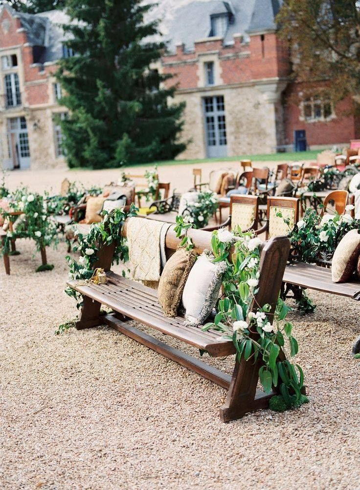 Wedding bench strewn with vine