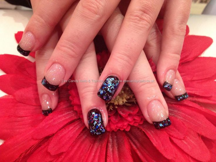 Acrylic nails with black polish and glitter on top