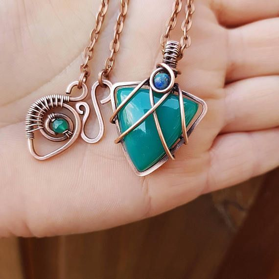Unique copper wire jewelry - a beautiful green onyx pendant. This triangle pendant is entirely handcrafted, shaped by hand. This gorgeous green stone is secured in the wire with the unique technique of wire wrapping. The small bead is a 4mm azurite stone. The clasp of this handmade #wirejewelry