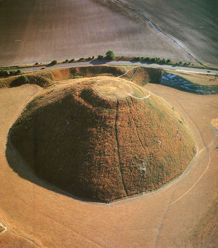 Silbury Hill, UK. Silbury Hill, near Avebury in Wiltshire, is the largest prehistoric man-made mound in Europe. It was created around 2660 BCE and stands 130 feet high, but its purpose is unknown. Despite centuries of study and excavation, it remains one of the most enigmatic of British prehistoric sites.