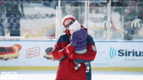 Holtby and his daughter Belle, her first time on the ice. Winter Classic 2014. The feels....