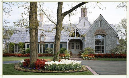 How charming is this house? I love the gables, stone, and landscaping. The French Tangerine: ~ house story