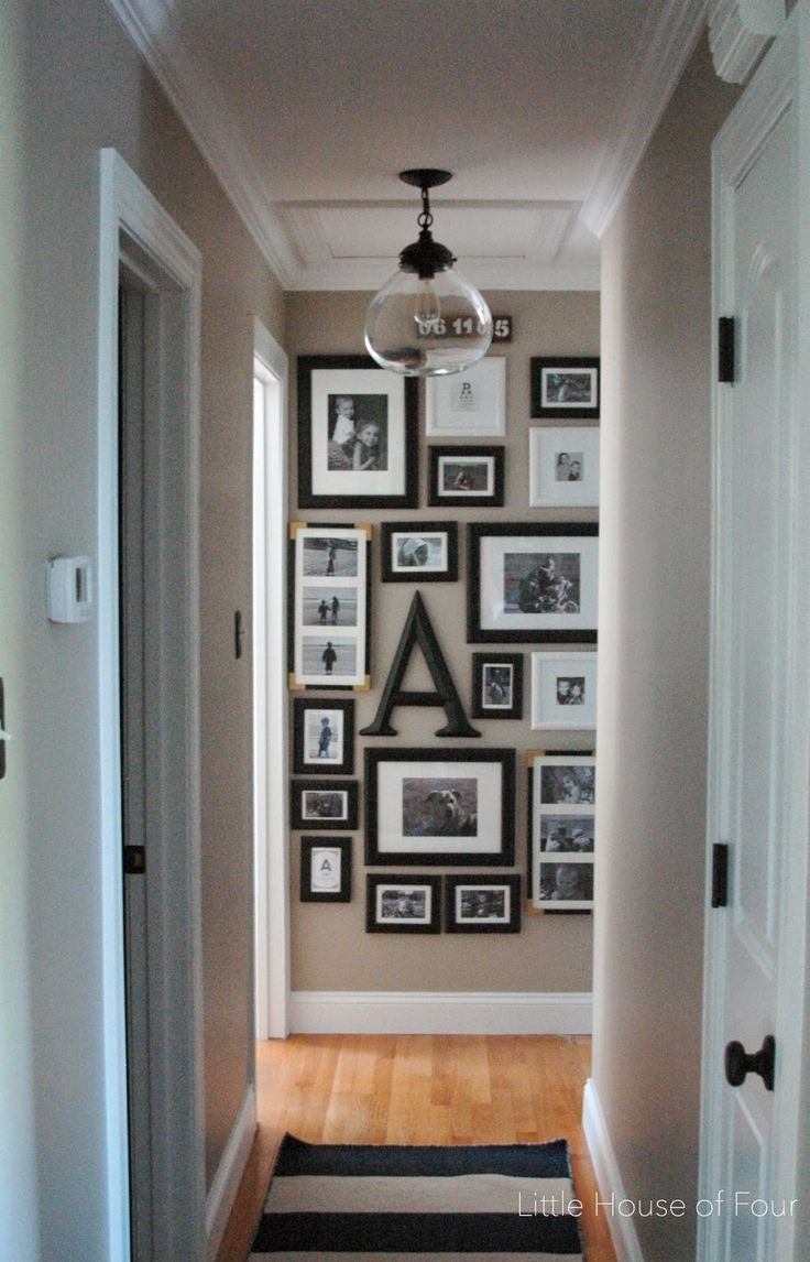 Gallery walls are nothing new, but positioning one at the end of a long hall is unexpected and delights passersby as they walk through the house. See more at Little House of Four »  - GoodHousekeeping.com