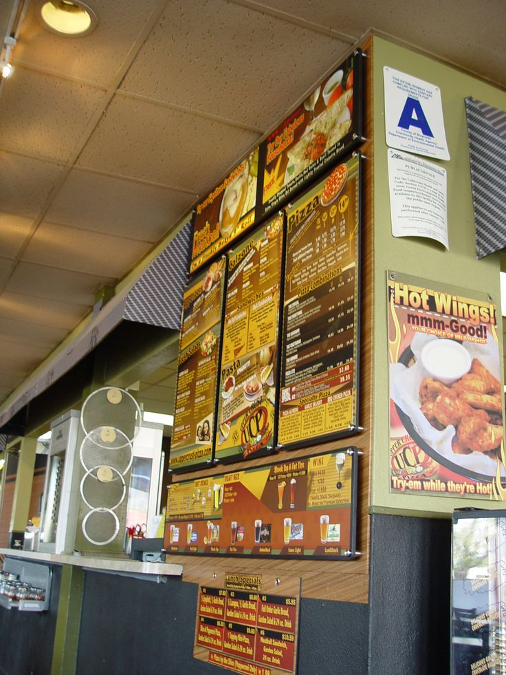 Custom designed menu board designed by and installed by DesertWraps.com. You can see this menu board at Upper Crust Pizza in Cathedral City, CA. Contact DesertWraps.com for more info at 760-935-3600. #Menu #CustomDesign #Pizza #CathedralCity #LargeFormatPrinting