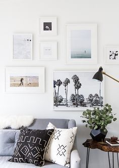 We love how Sarah Sherman Samuel framed her photographs on her living room wall. So minimal and stylish.
