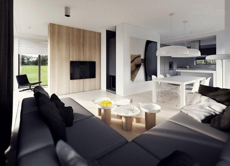 TAMIZO architecture intérieure moderne dans le salon avec canapé d'angle, panneau mural en bois clair et tables basses en bois