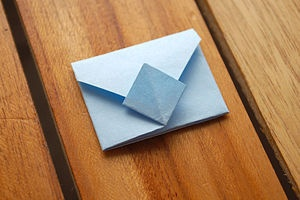 From a square piece of paper, fold it into an origami envelope. :: quick, easy, and a way to send a private note or letter in an artsy way! <3  tape down the diamond shape and it'll work through the USPS!