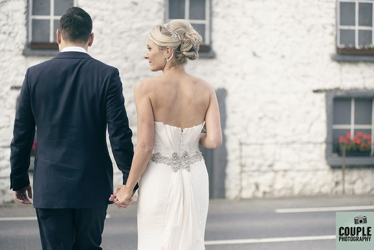 The bride & groom outside a cute white washed ruin. Weddings at Durrow Castle photographed by Couple Photography.
