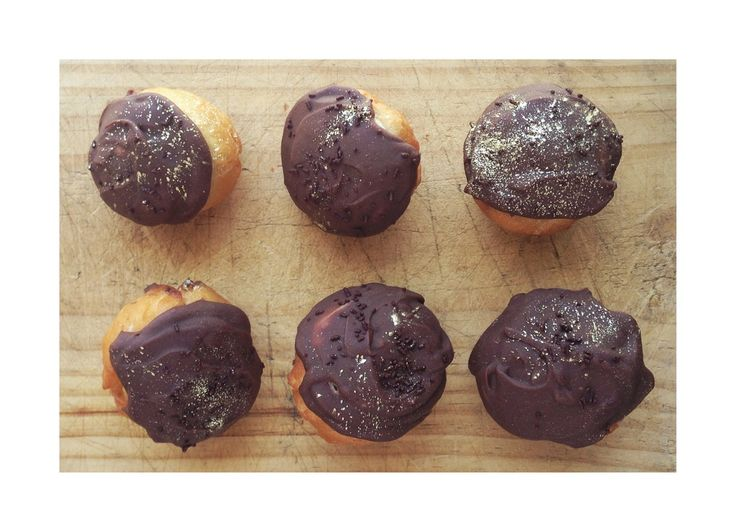 Mini Fried Doughnuts with Milktart Filling, covered in Nutella Chocolate Ganache.  Baked by Sweet Tooth CPT https://www.facebook.com/sweettoothcpt Photo by Willem Lourens