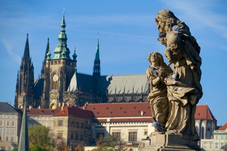 People walking on The Charles Bridge, Castle too far away and Our Lady stand with us.  Prague, Czech.