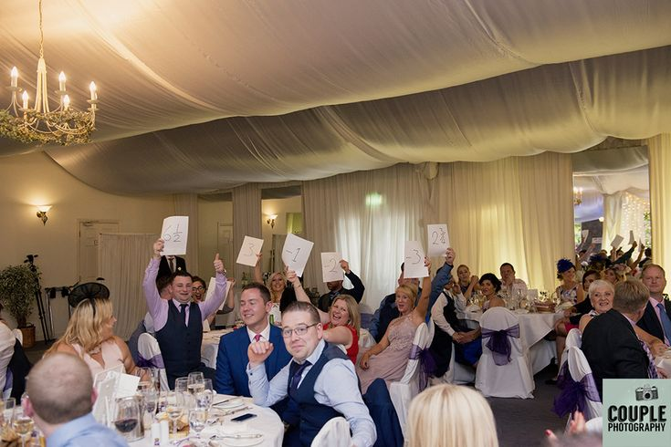 The guests have a laugh rating the speeches. Weddings at Rathsallagh House Hotel by Couple Photography.