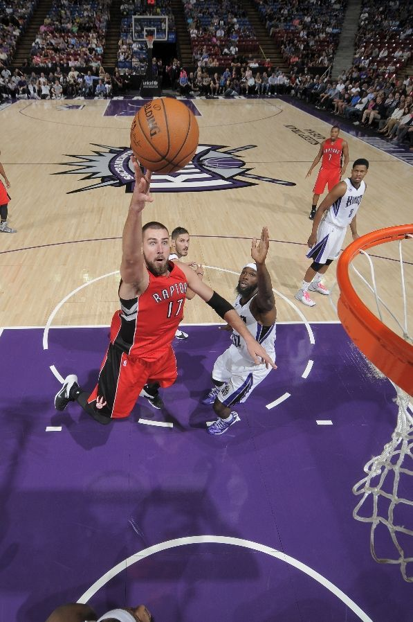 SACRAMENTO, CA - OCTOBER 7: Jonas Valanciunas #17 of the Toronto Raptors shoots a layup against the Sacramento Kings on October 7, 2014 at Sleep Train Arena in Sacramento, California. NOTE TO USER: User expressly acknowledges and agrees that, by downloading and or using this photograph, User is consenting to the terms and conditions of the Getty Images Agreement. Mandatory Copyright Notice: Copyright 2014 NBAE (Photo by Rocky Widner/NBAE via Getty Images)