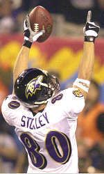 Super Bowl XXXV | Brandon Stokley offers a salute after his 38-yard TD catch in the first quarter.