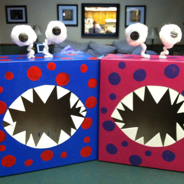 Monster Valentine boxes for school. These are made out of cake boxes from Joanne's. I painted then with cheap craft paint, then made the polka dots.  Let dry then cover with modpodge. Glue on eyes and cut teeth out of white craft foam.
