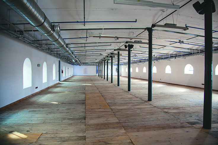Exhibition space with an original wooden XIX century floor in Fabryka Sztuki [Art Factory]  in Lodz, Poland.