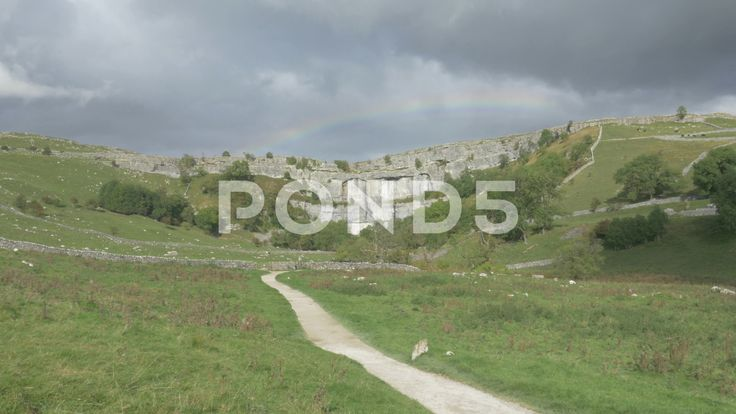 4K Rainbow Over Malham Cove Lime Stone Cliff Woodland Trees - Stock Footage | by RyanJonesFilms