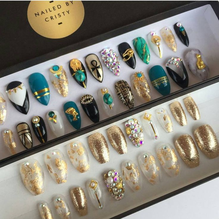 Gorgeous nails by @nailedbycristy  .  Featured Egyptian charms and Swarovski crystals are available at DAILYCHARME.COM