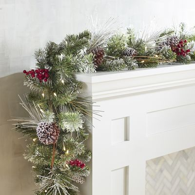 Add a touch of frost to your holiday decorating with our handcrafted, pre-lit garland. All decked out in natural pinecones, faux flourishes and shining lights, it gives extra glimmer to banisters, mantels and doorways. Exclusively Pier 1 Imports.