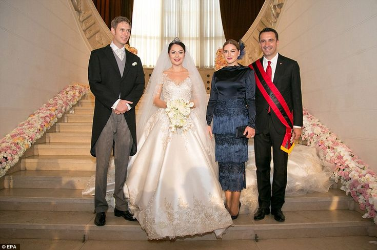 The newly weds with Areola Xoxa and her husband Tirana Mayor Erion Veliaj smile for a picture after the wedding ceremony