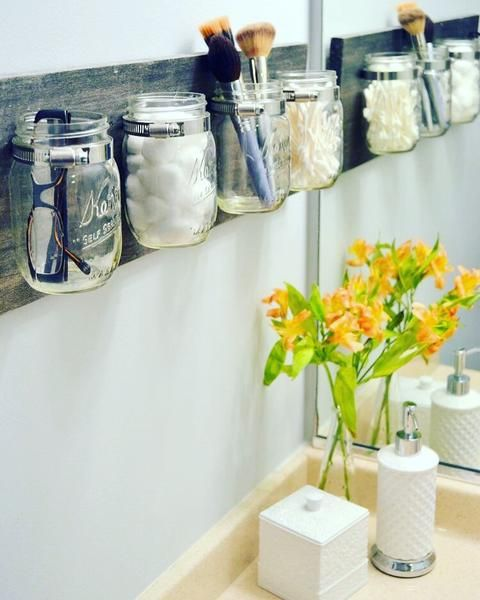 What a fabulous rustic addition to any home! Give this as a gift or keep it for yourself, or both! This Mason jar wall organizer can be used in bathrooms for be