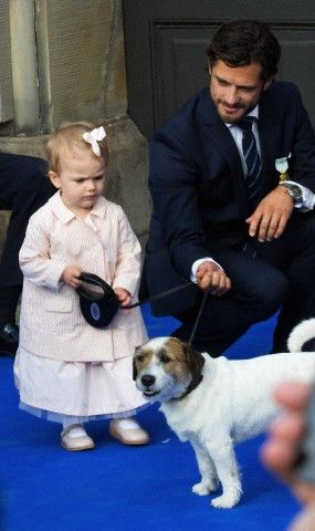Adorable Princess Estelle took over the royal dog leash while her uncle Prince Carl Philip ensure her safety during celebration of King Carl Gustaf's 40th jubilee at the inner courtyard of the Royal Palace, 15 Sep 2013.