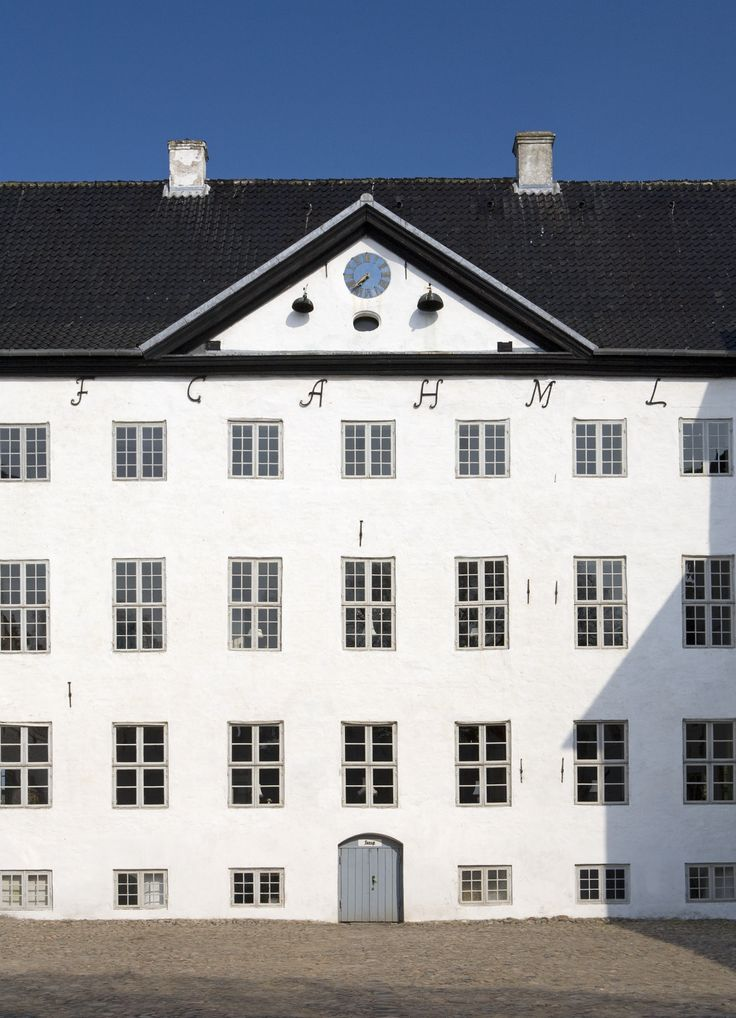 The main building of Dragsholm Castle. Housing one of Denmarks finest gourmet restaurants with Claus Henriksen in front Located in Odsherred Denmark.