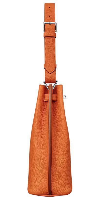 Hermes - So Kelly bag in orange leather. Side view.