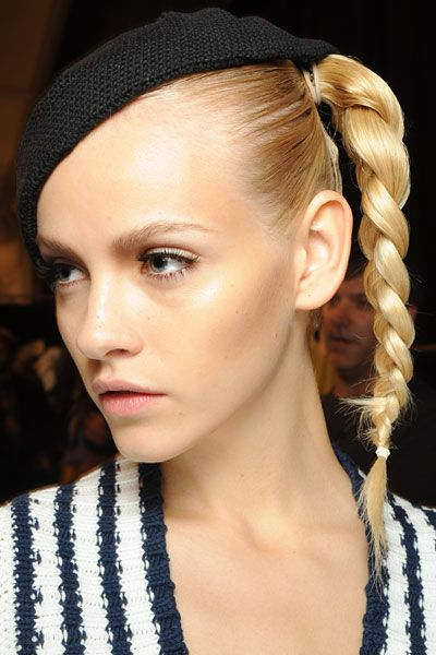 Model with braided hair and hat