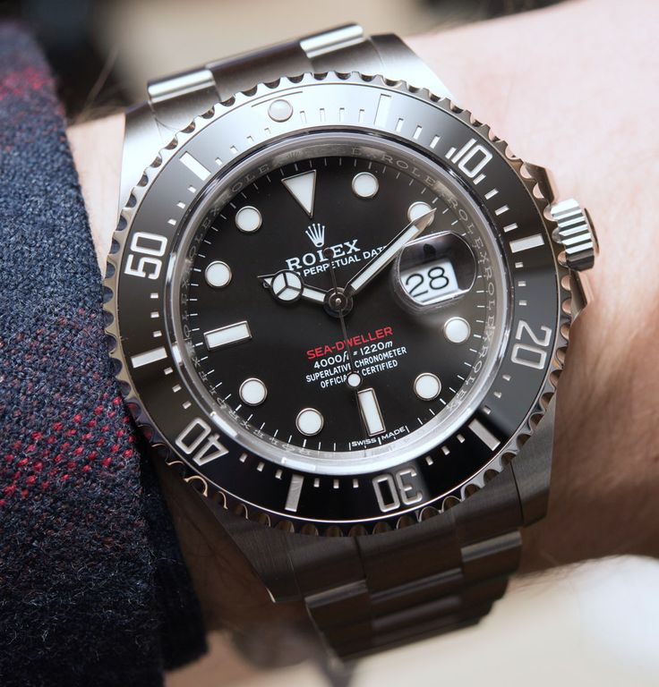 First Hands-On Live! Rolex Sea-Dweller 126600 Watch Marks 50th anniversary of the Sea-Dweller. Black Cerachrom bezel, 43mm case and cyclops lens over the date. See how our David Bredan felt about the watch in our latest article.