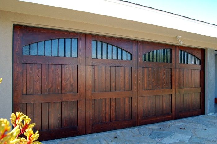 A Wood Garage Door adds both value and curb appeal to a home. | Americana - Rustic with Elliptical Arch V-Grooved Panel and Lites