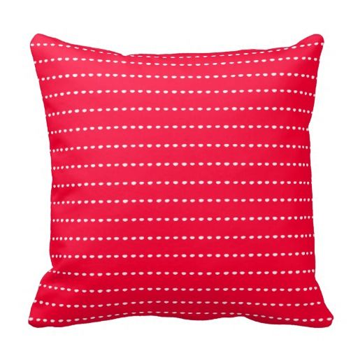 Red pillow with a simple dotted line pattern