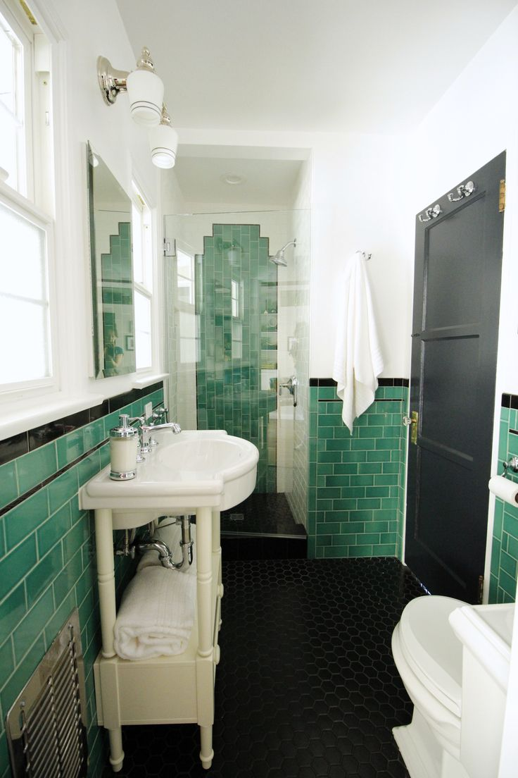 this vintage style bathroom features green subway tile along with chrome fixtures credits the