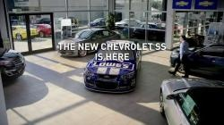 Jimmy Johnson gets in a new Chevrolet SS to enjoy the new car smell.
