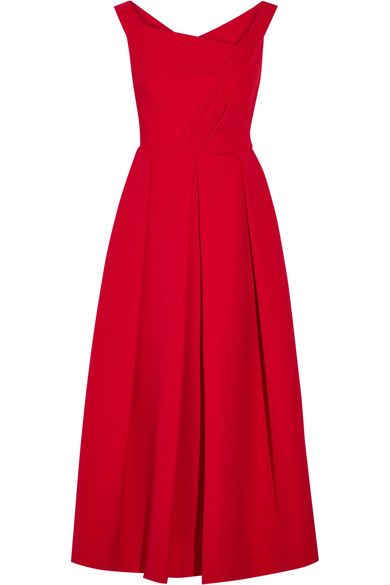 Preen by Thornton Bregazzi's 'Finella' dress was worn by the Duchess of Cambridge during her recent Royal Tour of Canada. Made from red stretch-crepe, it has a striking asymmetric neckline that frames the shoulders beautifully and a voluminous box-pleated skirt. Take your styling cues from the Duchess and wear this piece with pumps and glamorous earrings.