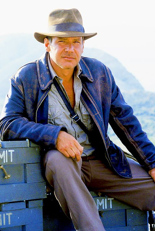 "Harrison Ford on the set of ""Indiana Jones and the Last Crusade"" Leather jackets became heavily popularised during the 1940s and 50s due to various actors wearing them in movies. They created a 'cool' and 'rebellious' vibe."