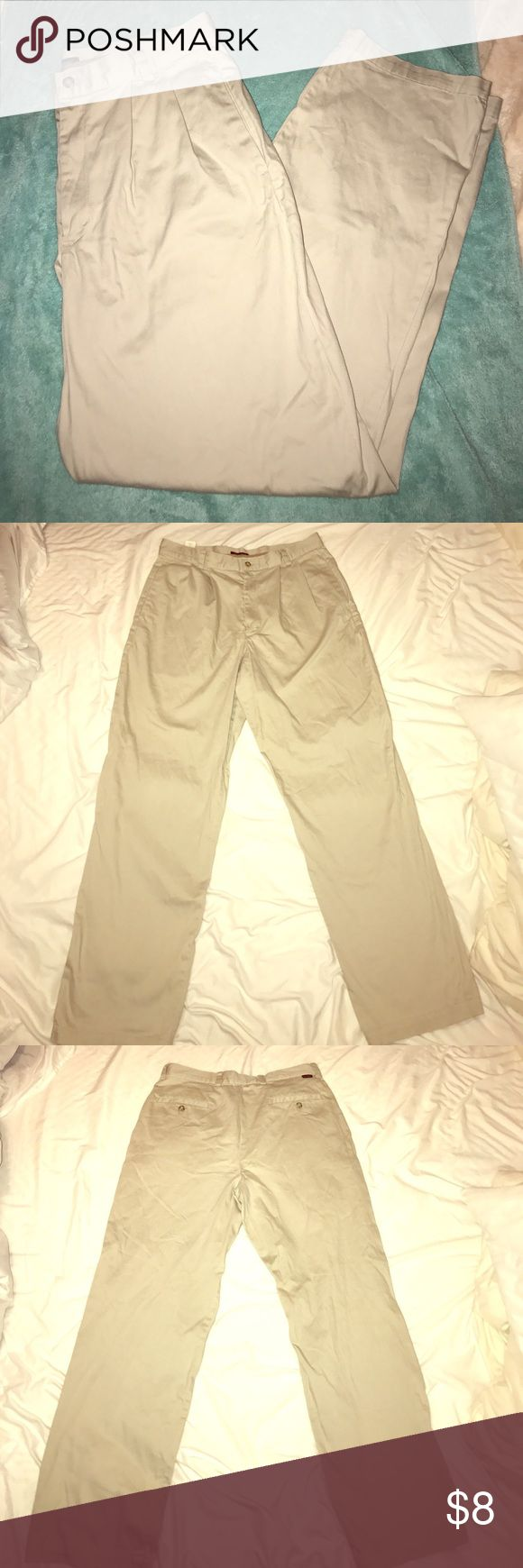 Dockers Khaki Slacks Men's 34W x 32L Excellent condition Khaki colored men's Docker brand slacks. Two pockets on each side and two in the back side with button closure. Front side is a zip up closure with button closure. Size 34Wx 32L. No holes rips or tears!!! Dockers Pants Dress