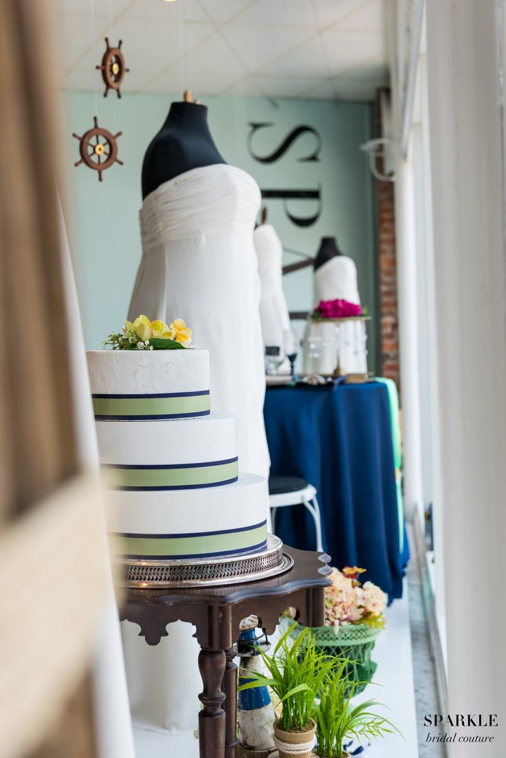 Come by SPARKLE bridal couture today and see this gorgeous Nautical themed window in person!  #Nauticalwedding #Navyblue #Chiffongowns #Sparklebridal #Plussizebridal #Elegantinspirationseventsandweddings #Lelanipaularphotography