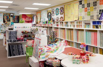 An imaginative oasis that dazzles with clever displays and bright fabrics encourages quilters to continue a creative legacy at Millie P's in Minnesota.